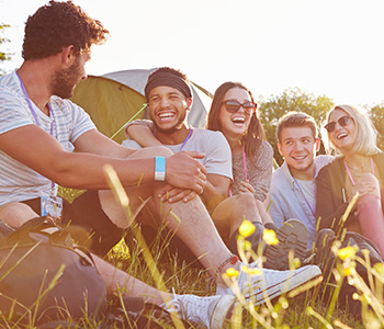 group of people smiling outdoors