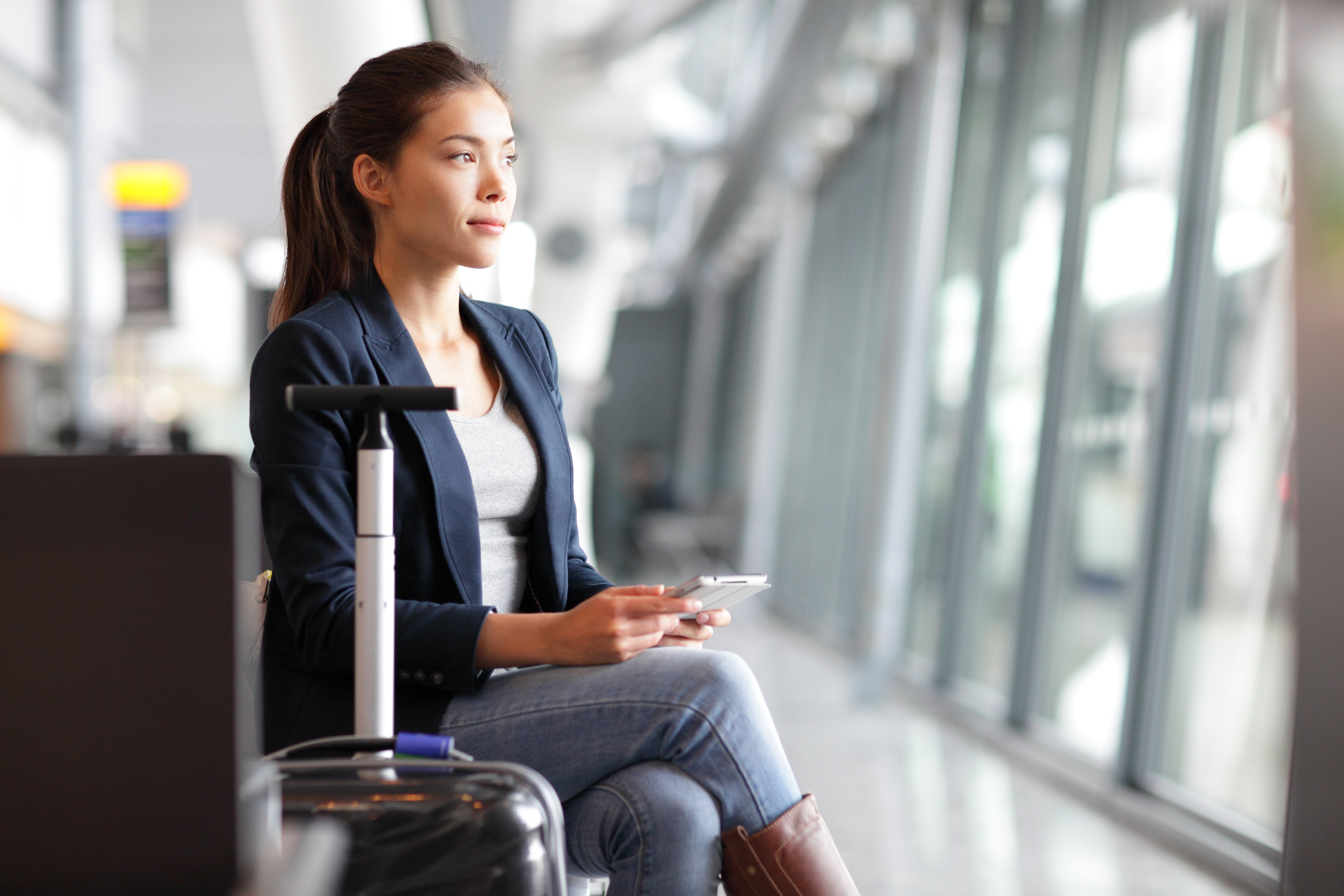 Woman in airport traveling with jewelry