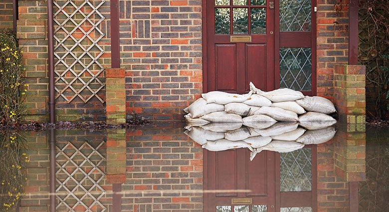 Home guarded with sand bags against rising water
