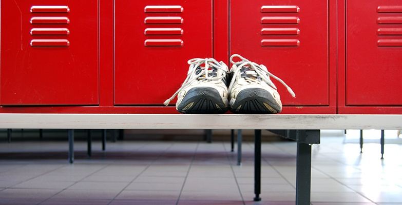 Gym shoes on bench in locker room