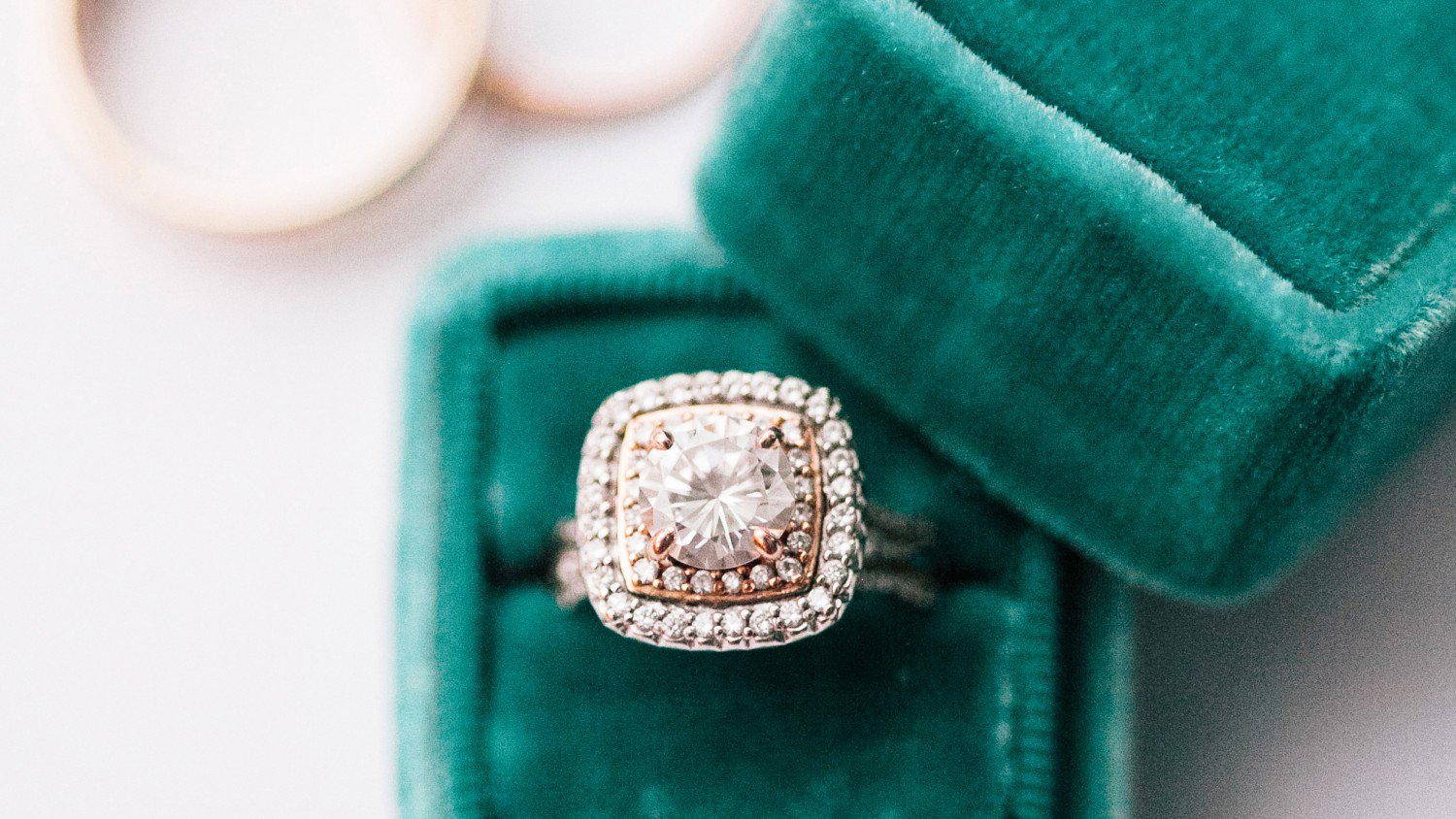 Double halo engagement ring in green box