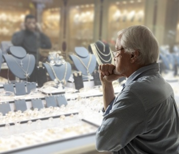 man browsing jewelry