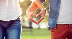Holding hands to create heart