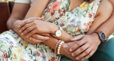 couple holding hands with jewelry